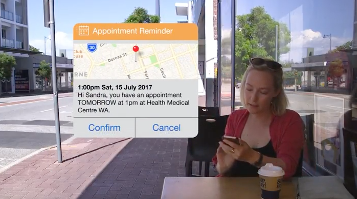 Woman receiving appointment reminder on phone