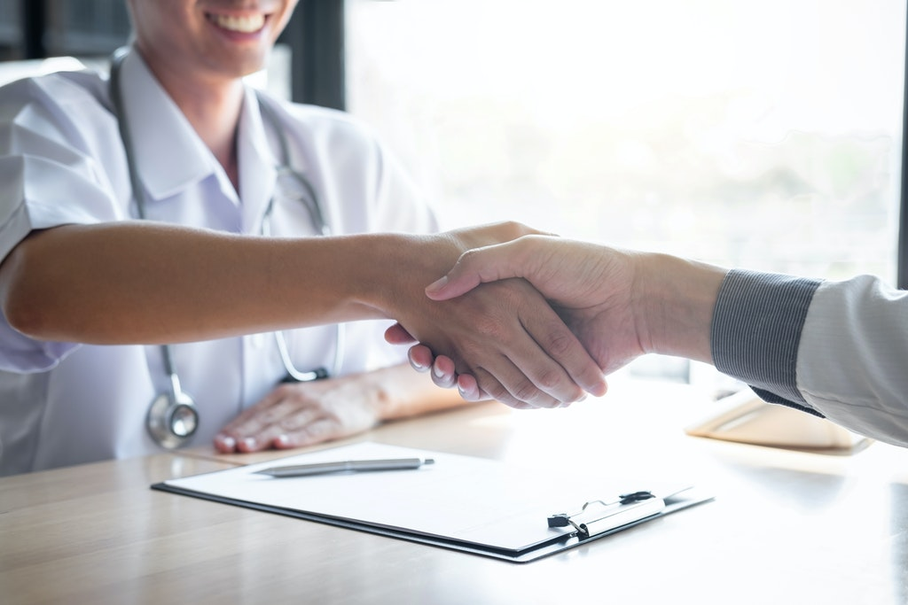Doctor shaking hands with a new patient