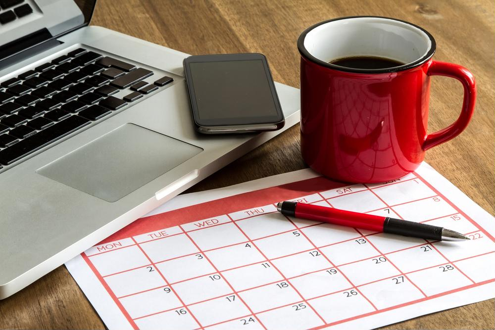Coffee, laptop, mobile phone and calendar
