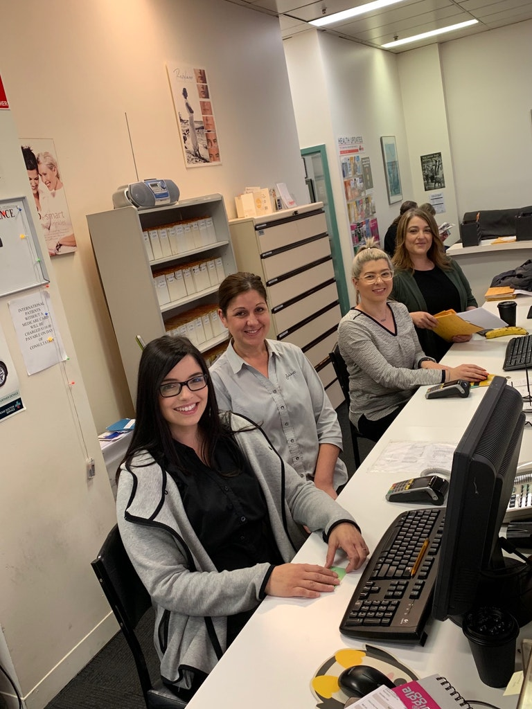 The front desk team at Ultimate Health